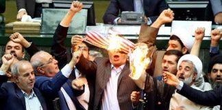 Iran politicians set fire to America Flag in Parliament