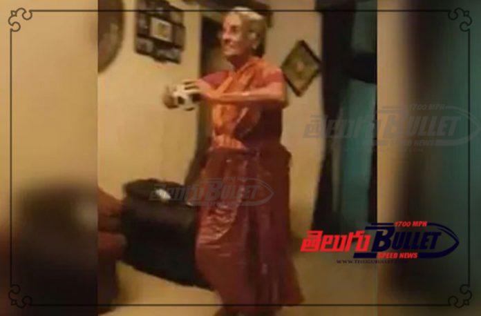 old woman imitating bumrah bowling