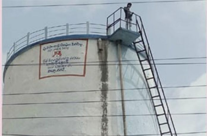 Father's third wedding ... son to climb a water tank